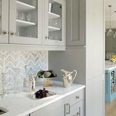 Liz Caan Interiors - kitchens - herringbone backsplash, marble tile herringbone backsplash, marble herringbone backsplash, kitchen herringbone backsplash, herringbone kitchen backsplash, butlers pantry, butler pantry, glass front cabinets, gray cabinets, gray kitchen cabinets, gray butlers pantry cabinets, butlers pantry sinks, hammered metal sink, gooseneck faucet, sterling islver tray,
