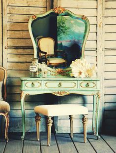 This very 1930's Carole Lombard-esque vanity is even more charming in this rustic setting. Love the aqua/gilding against the chippy shutters.