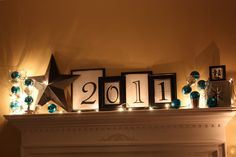 I like this idea with the last name on the mantle or just first initials or holiday things like boo for halloween