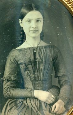 Young girl, wearing ring on index finger. Love the pigtails. Civil War era.