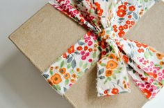Fabric gift wrapping ribbon can be used over and over again