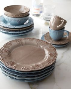 "20-Piece ""Fleur-de-Lis"" Dinnerware Service $23.90 - Scalloped edges make even neutral colors suitable for this look. Layer it with floral plates so it doesn't go too French country"