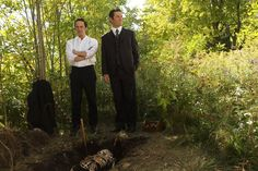 Constable Crabtree (Jonny Harris) and Detective Murdoch (Yannick Bisson) look around the grave site.