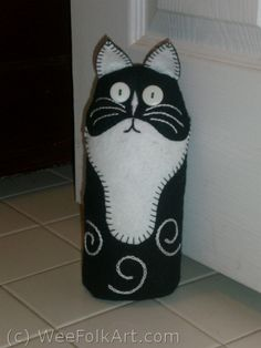 Cat door stopper. Excellent for when I go away and need to prop open the doors so the cat doesn't lock herself in.