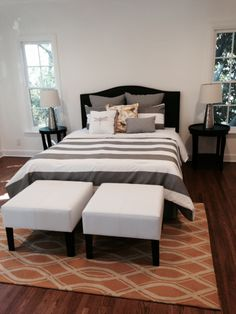 I wanted the guest room to be a bit more playful, so I chose bold striped gray bedding against a gold trellis rug.