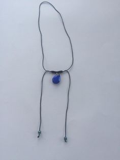 handmade macrame necklace with black cord and blue elements