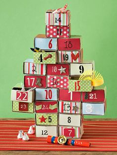 """Matchbox Advent Calendar: Design by Ursula Page: A fun treat for kids and adults alike, this tree-shape Advent calendar is a cinch to make with a few inexpensive matchboxes and spare scrap supplies. Cover the outside shell of 24 matchboxes with decorative cardstock or wrapping paper. On the front of each matchbox glue patterned paper and fun accents, such as ribbon, charms, and stickers. Finish each box with a number on the front in varying stencils, stickers, and writing. Place fun toys…"