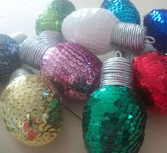 These jumbo Styrofoam Christmas Lights will knock your socks off! Christmas lights are already cheerful decorations, but these glittery, jumbo Christmas bulbs are even more fabulous. Fill a clear vase with these oversize lights. Easy Christmas Ornaments, Merry Christmas, Christmas Light Bulbs, Christmas Mantels, How To Make Ornaments, Simple Christmas, Christmas Lights, Christmas Holidays, Christmas Ideas