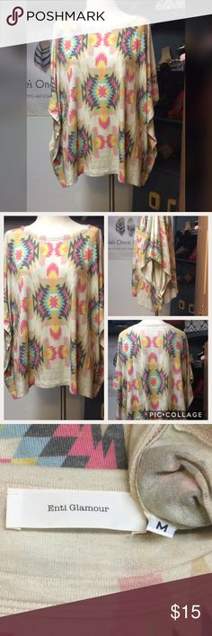 Enti Glamour Poncho Aztec print being Poncho. Wear over a bathing suit or over a tank or tee with jeans. Be cute over a solid tank pencil dress. Gently used consignment piece. Enti Glamour Tops Blouses