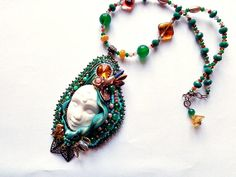Shibori bead embroidery pendant green with polymer clay handmade face and Swarovski crystals and glass beads on Etsy, $98.67 AUD