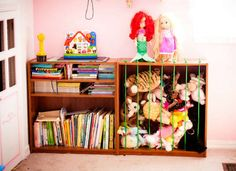 Convert a bookcase to house all the kids' stuffed animals. Bungee cords keep them in but make them easy to get out, too.