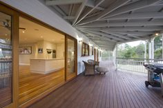 The front verandah includes a large dedicated entertaining area with ceilings lined with external grade VJ board. Front Verandah, Queenslander, Energy Efficient Homes, Outdoor Living, Outdoor Decor, Outdoor Entertaining, Building A House, New Homes, Traditional