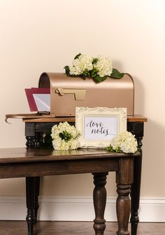 Use Rust-Oleum Vitange Metallic Rose Gold spray paint to transform a plain mailbox into a beautiful centerpiece that's perfect for weddings or any special event.