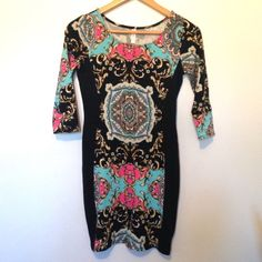 Black Floral Bodycon Holiday Dress Cute and fun for holiday parties! Comfy floral bodycon dress with slimming black side panels. Xhilaration for Target, size small. Great condition! Xhilaration Dresses Mini