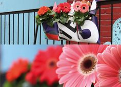 Flower pots : Otra flowerpots are designed to be hung on balcony guardrails. Initially inspired by gardener overalls, they are anchored in a modern way whilst retaining an aspect traditional to the world of gardening.