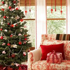 Christmas Shine:   Clear glass ornaments hung in windows will catch light and send sparkles throughout the room. String an ornament onto a length of ribbon. Attach the end of the ribbon into the wall above the window frame with a small nail or thumbtack. Hang just one bauble as a focal point, or hang multiples for extra