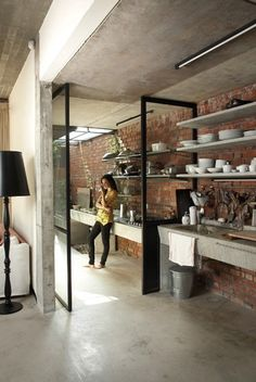 black & white and brick...the floating countertop looks great, but storage
