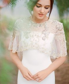 Awesome Weeding Dress.Very Nice To Look At.Beaded cape with simple bodice.