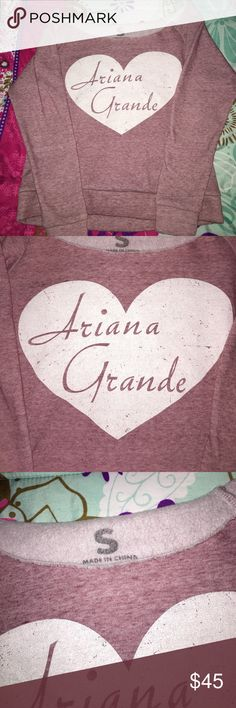 Ariana Grande Sweatshirt This is Ariana Grande merchendise circa about 2012. It is EXTREMELY rare and hard to come buy anywhere online. This is great for a huge Ariana fan who wants to collect merchandise or a fan who wants to wear the shirt to one of her concerts! It is a small but the top is very roomy and hangs off the shoulders a bit. It would best fit someone with a busty chest so the sleeves don't fall down. I just purchased it from another posher and it has never been worn before…