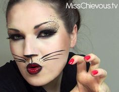 This gorgeous, feisty Halloween cat makeup look comes from Swiss beauty vlogger Julia Graf. Create a dramatic cat eye look using dark brown, black, tan, and pink eye shadows, and thickly line the tops and bottoms of the eyes with black gel line. Use this liner to create the wing too. Create leopard spots on the eyelid and up over the eyebrows by drawing tiny c's and u's. Liquid liner whiskers and two-tone lips finish off the look.