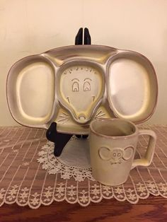 Frankoma Child's Set (#257), featuring mouse-design plate and cup, in Desert Gold. (JKT)