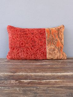 """split personality  the zither pillow, in eye catching shades of red + orange, keeps things fresh + brings color + texture to any room. embroidered with velvety soft viscose, this pillow remains classy yet modern.  down feather insert included - zipper closure  100% viscose pile - dry clean only  red's online exclusives are available as special orders + are not currently available at our brick + mortar location. please allow 2-4 weeks from order to delivery.  dimensions: 22""""w x 14""""h"""