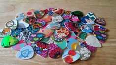 10 Up-Cycled Guitar Picks.   Up-Cycled: Verb. Reuse (discarded objects or material) in such a way as to create a product of a higher quality or value than the original.  Each sanded slightly on the ed