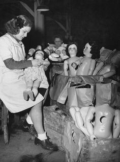 Doll factory worker in France, 1940