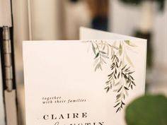 Simple white wedding invitation with green leaf detailing. See more wedding photos of Austin & Claire's wedding on WeddingWire!