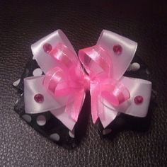 Black and white with a touch of hot pink bow