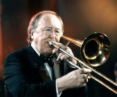 "Chris Barber - British Dixieland jazz trombonist and bandleader. Had big 1962 hit ""Stranger On the Shore"" with Kenny Ball and Acker Bilk and played briefly in John Mayall's Bluesbreakers."