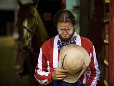 See a photo of a barrel clown at a Texas rodeo from National Geographic.