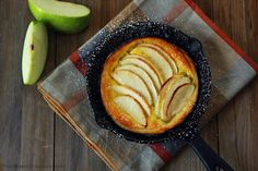 An apple pie open baked in a skillet and filled with a layer of creamy vanilla custard. The only thing you need to add is a dollop of vanilla ice cream.