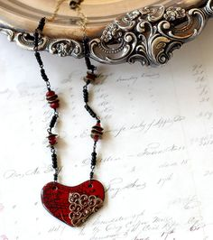 Red Enamel Jewelry  Reversible Necklace  by ShabbyCottageAdorned Red enamel jewelry is a standout addition to your collection. And this fun necklace is reversible! See the last two photos to see this as a dark blue pendant necklace. Now that is functional and its beaded chain gives you chic appeal.