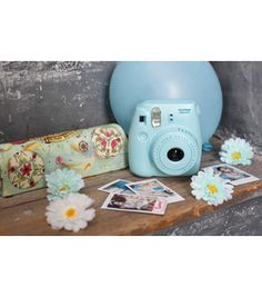 The FujiFilm Mini 8 camera provides high quality instant photos in just over 90 seconds. The Instax 8 automatically determines the best brightness for taking pictures. Fuji Instax Mini, Instax Mini 8 Blue, Instax 8, Fujifilm Instax Mini 8, Instax Camera, Polaroid Camera Pictures, Polaroid Cameras, Mini 8 Camera, Camera Case