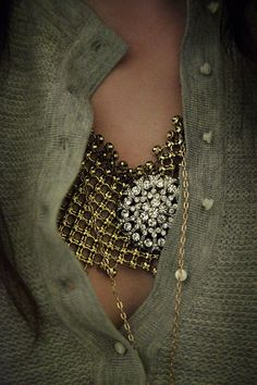 Necklace. I THOUGHT THAT WAS A BRA, EITHER WAY LOOKS COOL
