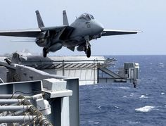 f-14 tomcat takes off from harry s truman aircraft carrier