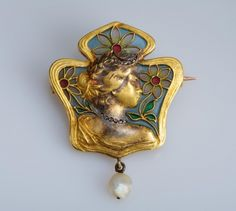 Brooch. Gold (two alloy), diamond and pearl. Austrian import mark used between 1891 - 1901. France 1900. Art Noveau