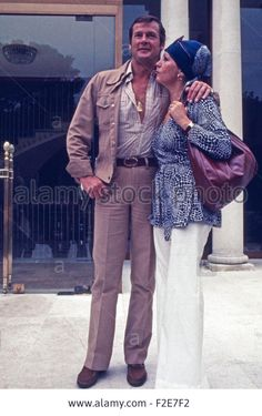 British actor Roger Moore with his wife Luisa Mattioli, Germany January 1970s. - F2E7F2 from Alamy's library.