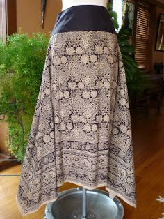 """lovely skirt made from patterned fabric (repurposed 58"""" square tablecloth!) and a black yoke from a skirt sloper. Nearly zero waste."""