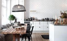Kitchen layout.  Banquette.  Tiled to the ceiling. via Simply Grove