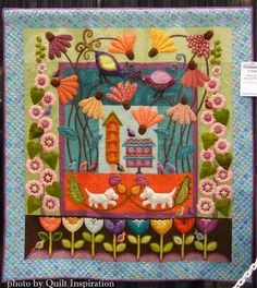 """Duncan's Garden Party, 64 x 70"""", by Karolyn """"Nubin"""" Jensen.  Inspired by Sue Spargo.  2014 AQS show. Photo by Quilt Inspiration."""
