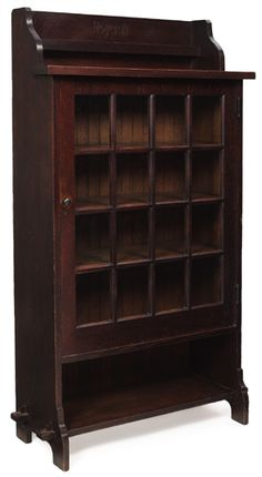 Rare Roycroft bookcase, single door with sixteen glass panes.