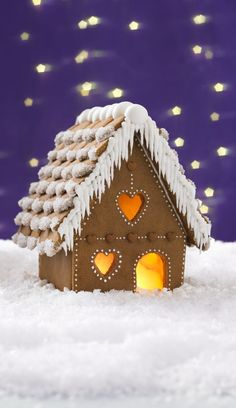 A step-by-step guide to making and assembling a beautiful gingerbread house complete with snow-capped roof and pretty piping - a great family project