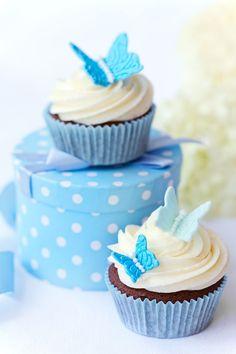 Cupcake decoration idea: blue butterflies for a Cinderella theme.