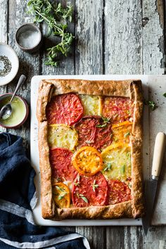This rustic heirloom tomato tart showcases colorful heirlooms in a shatteringly flaky gluten-free crust kissed with fresh oregano, mozzarella, and parmesan. Heirloom Tomato Tart, Heirloom Tomatoes, Gluten Free Crust, Gluten Free Recipes, Vegetarian Recipes, Ciabatta, Bojon Gourmet, Thing 1, Pasta
