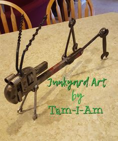 Junkyard Art by Tam-I-Am. Repurposed wrenches make Jiminy Cricket. Scrap metal art.