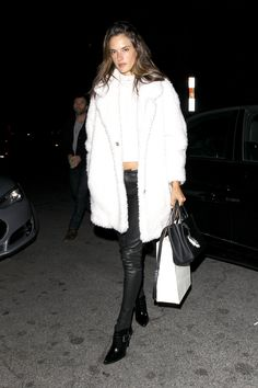 VS Angel Alessandra Ambrosio looks cozy in her nubby Gerard Darel over a cropped white turtleneck and  J Brand pants.   - HarpersBAZAAR.com