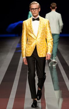 Canali    The yellow dinner jacket, especially because it's paired with that black bow-tie. Try a color for evening.