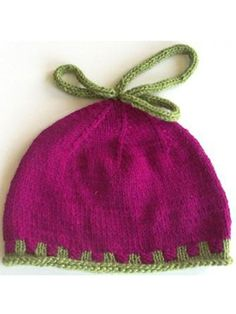 Free Knit Pattern Download -- This Magenta Hat with 2 Color Rib, designed by Kristin Nicholas, is featured in episode 4, season 2 of Knit and Crochet Now! TV. Learn more here: https://www.anniescatalog.com/knitandcrochetnow/patterns/detail.html?pattern_id=168&series=2